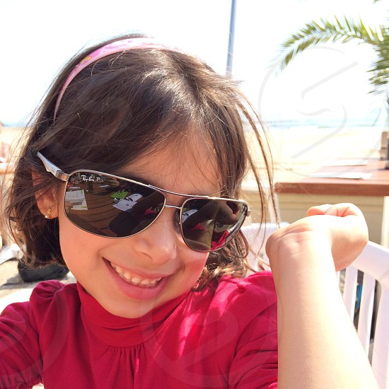 Girl with daddy's sunglasses photo