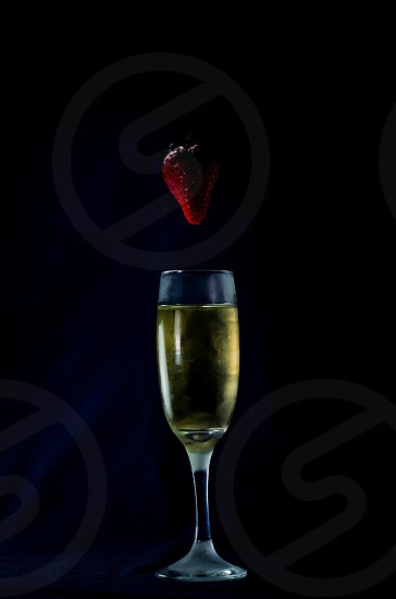 wine glass with strawberry  photo