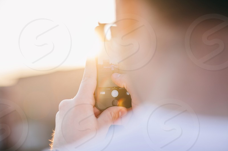 man using gadget photo