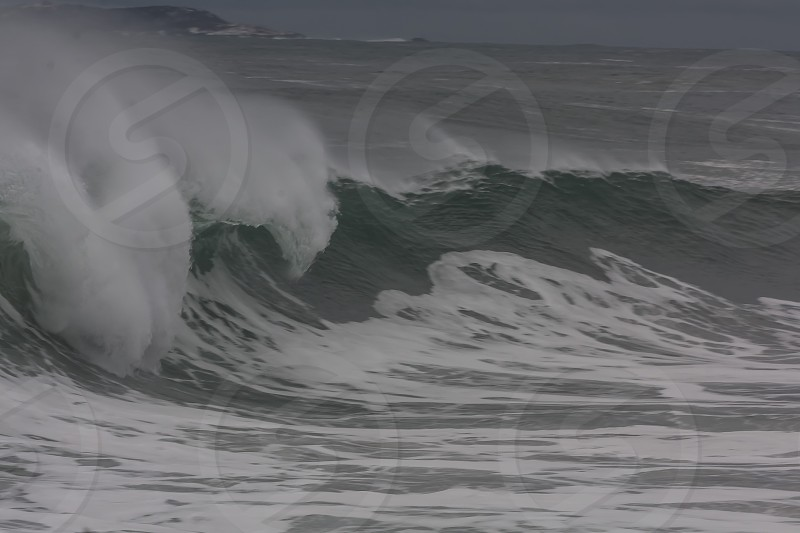 coast coastal storm waves surf spray green grey gray white winter weather photo