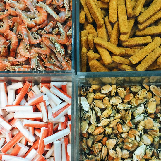 pink shrimps bread sticks nuts and snack sticks photo