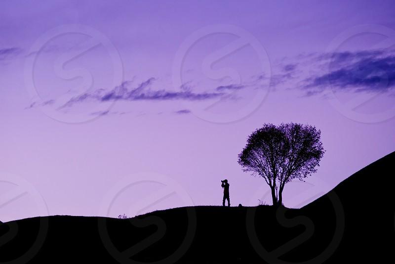 man on mountain silhouette photography photo