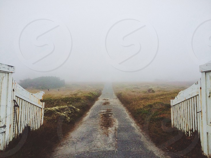 concrete road way with mist view photo