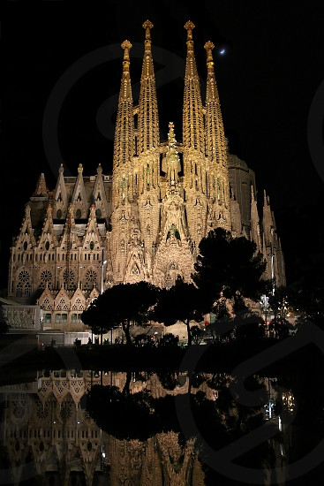 La Sagrada Familia Basilica night moon cathedral church Gaudi reflection photo