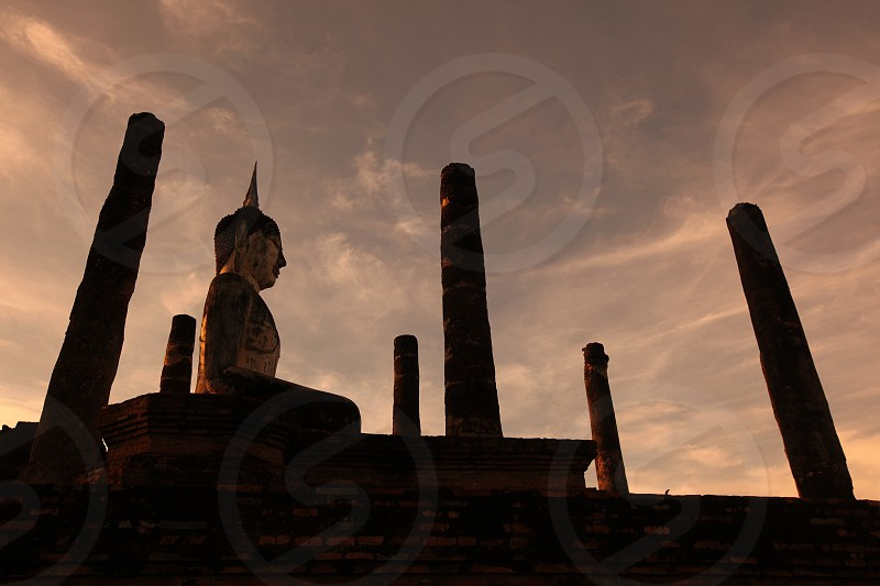 a Buddha at the Wat Mahathat Temple at the Si Satchanalai-Chaliang Historical Park in the Provinz Sukhothai in the north of Bangkok in Thailand Southeastasia. photo