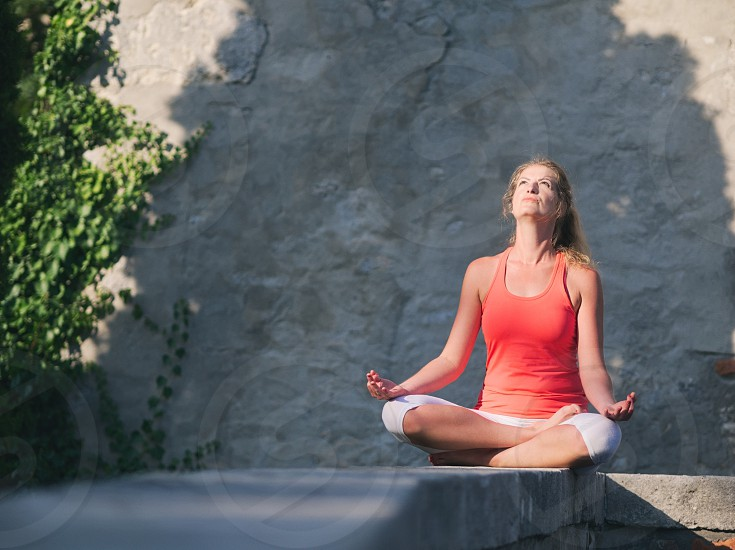 Woman in her Thirties Doing Yoga in the Park on a Summer Day photo
