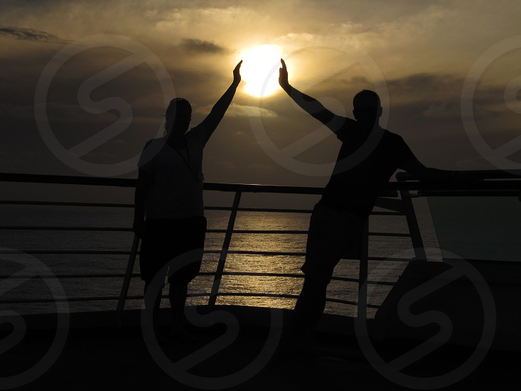two man waving their hands photo