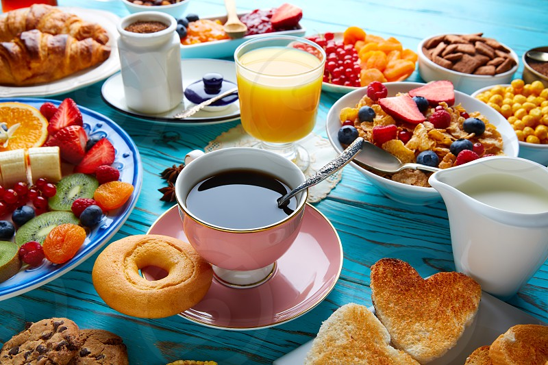 Breakfast buffet healthy continental coffee orange juice fruit salad croissant photo