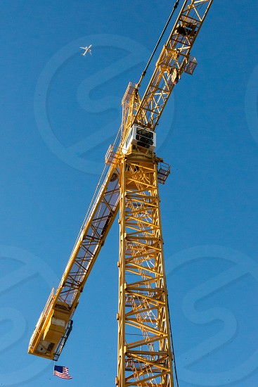 Crane on blue sky photo