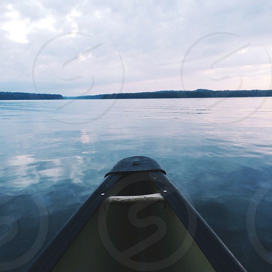 black and white canoe on body of water photo