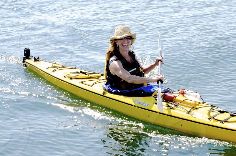 woman in black vest kayaking photo