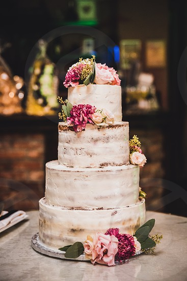 Vegan natural and healthy wedding cake decorated with flowers photo