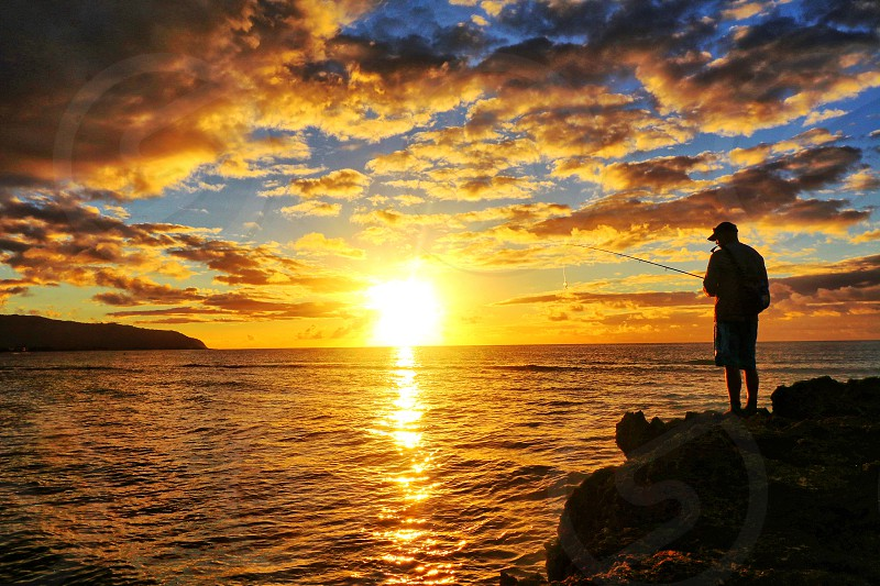 A Haleiwa fisherman catching a sunset on the North Shore Oahu Hawaii. photo