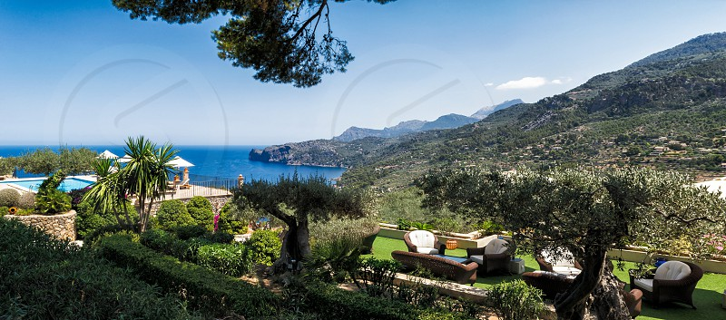 Mediterranean resort by the sea with old olive groves and the sitting area photo