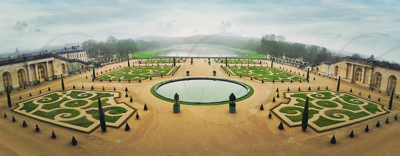 Panorama of Versailles Palace Gardens near Paris France. Greenhouse Park against the background of the Swiss basin. The Orangerie as world heritage. photo