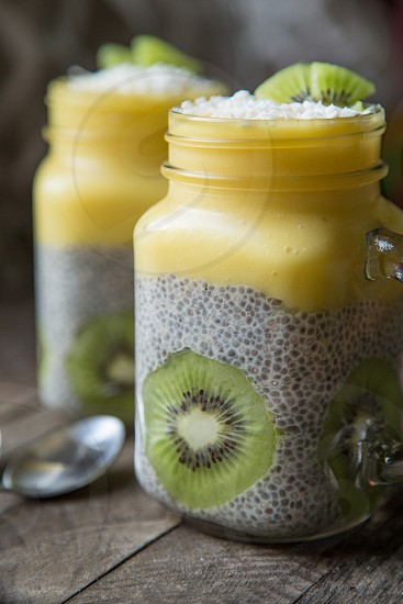 Tropical Chia Pudding - Mango Pineapple Smoothie - Garnished with Kiwi and Coconut Flakes photo
