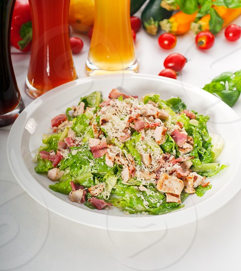 fresh classic caesar salad with red and blonde beer on background healthy meal MORE DELICIOUS FOOD ON PORTFOLIO photo