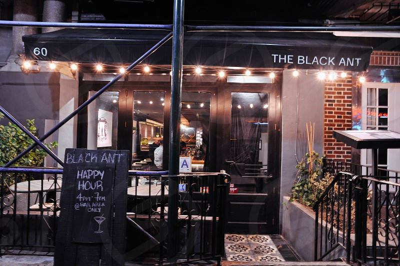 the black ant restaurant bar front with a happy hour chalkboard sign photo