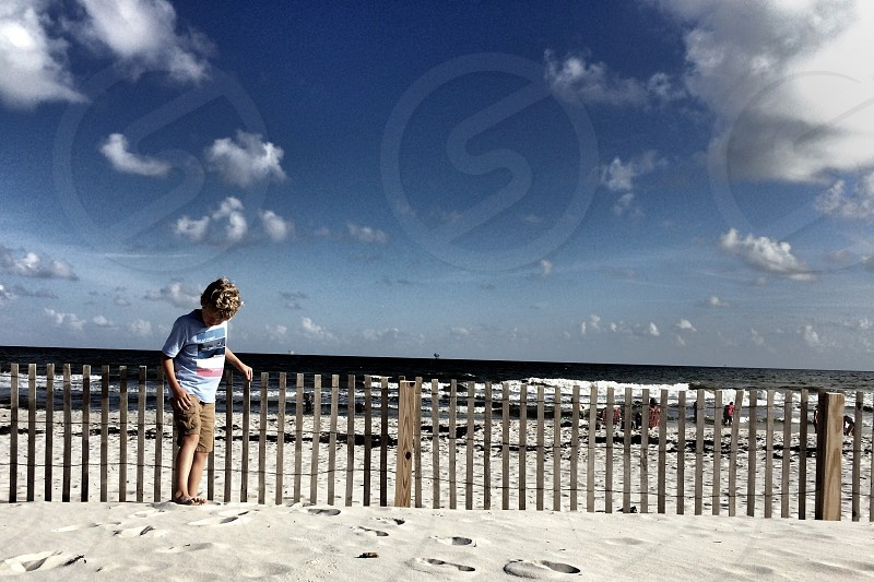 Beech summer fun sand ocean sky clouds photo