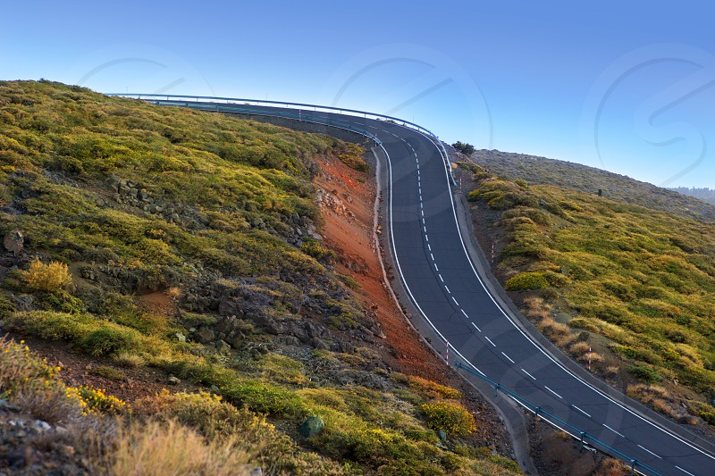 green mountain winding road curves dangerous for drivers photo