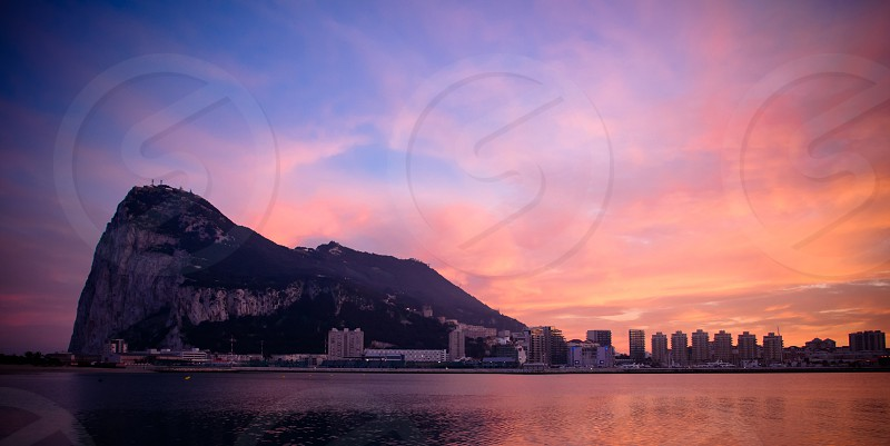 Beautiful sunset with the rock of Gibraltar  photo