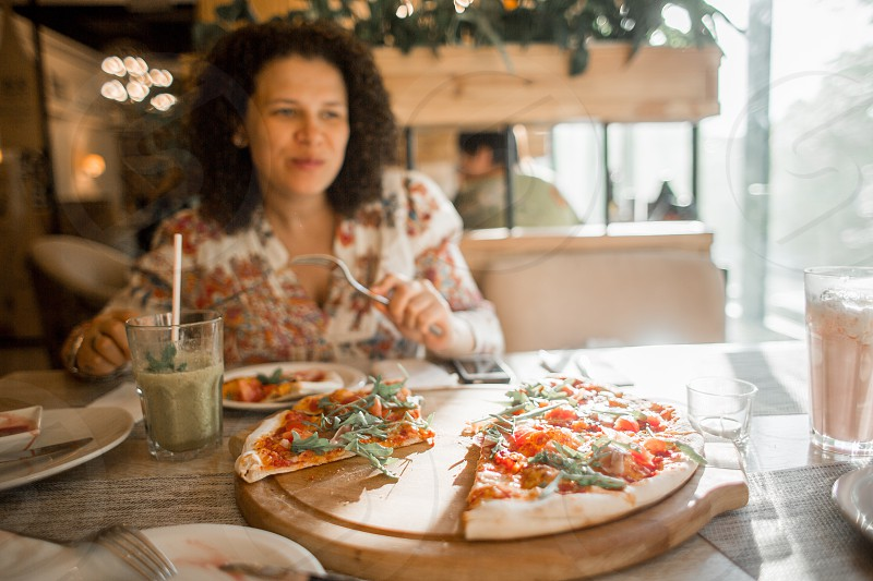 Young woman in a pizzeria cafe photo