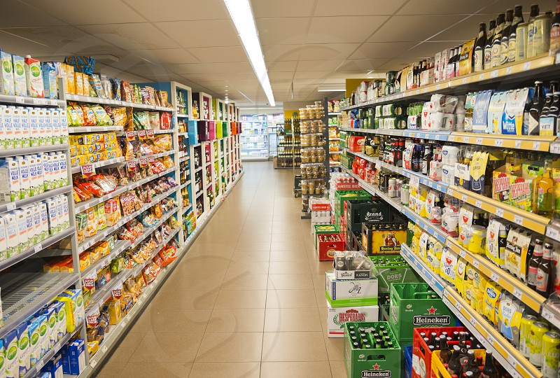 HILVERSUMHOLLAND09-01-2018:supermarket in holland with racks full of drinks and food like beer milk snacks and fastfood in Hilversum hilversum is the media city of holland photo