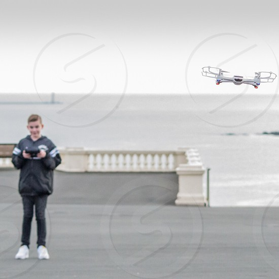 My son flying his drone on Plymouth Hoe photo