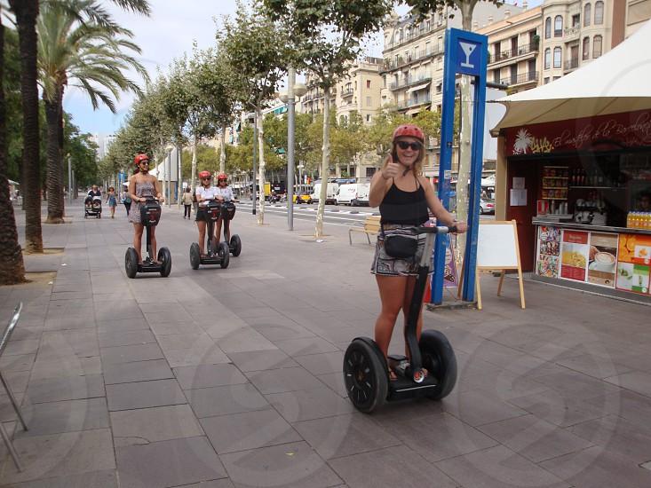 woman riding 2 wheel self balancing scooter photo