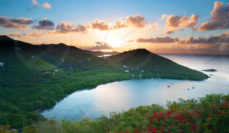 green mountain near ocean water photo