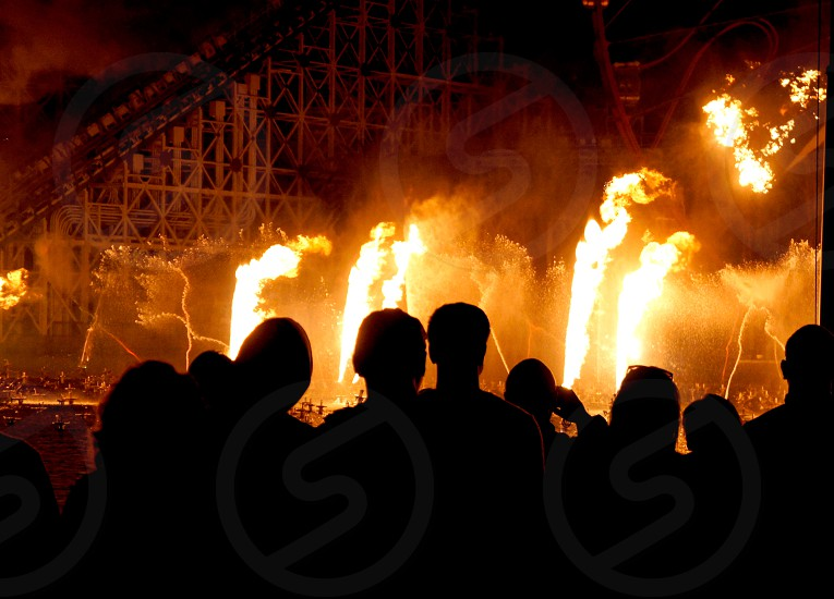 Spectators watching a fire show photo