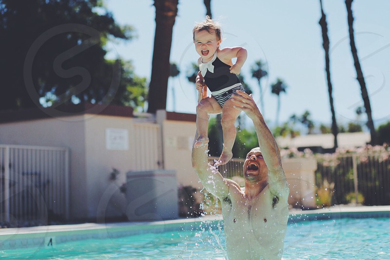 Baby toddler pool swim swimming splash smile smiling laughing water photo