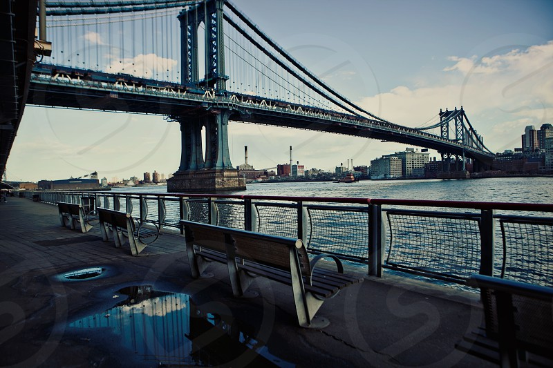 bridge over water and seating on the shore photo