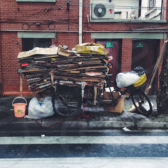 Shanghai three-wheeled bicycle laden with used cardboard boxes and bags ready for recycling. photo