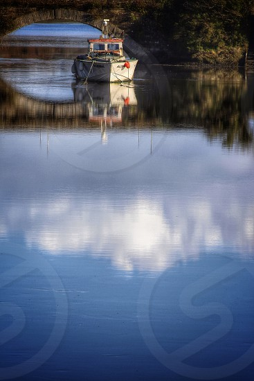 Ireland river bridge boat water reflection cloud fisherman fishing  photo