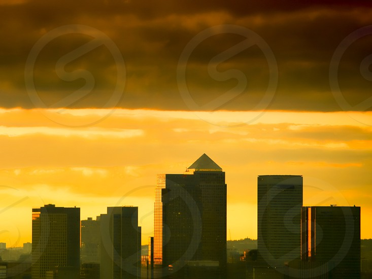 The skyscrapers of Canary Wharf London at sunset photo