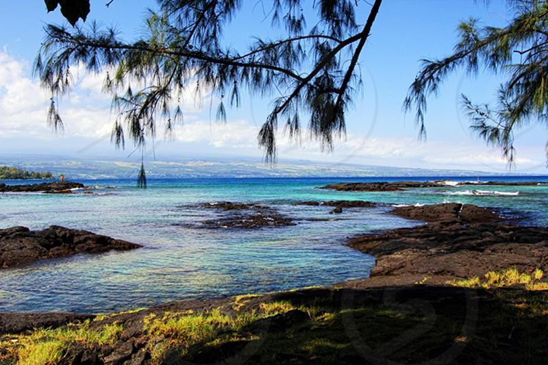 Beautiful beach in Hilo Hawaii. Beach ocean water blue water Hawaii photo
