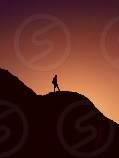 man standing in the mountain photo