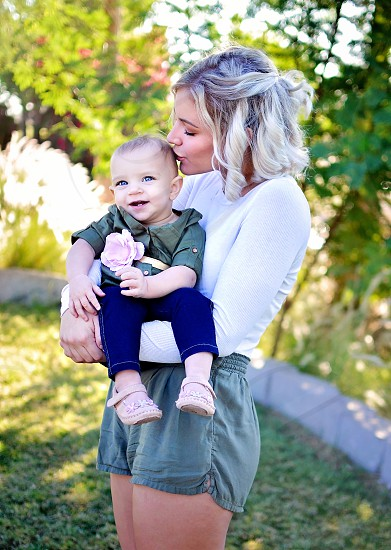 Family photos with toddler girl as focus photo