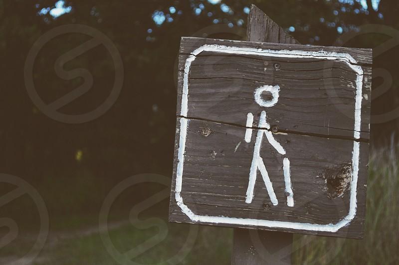 Hiking trailhead sign leaving a campsite. photo