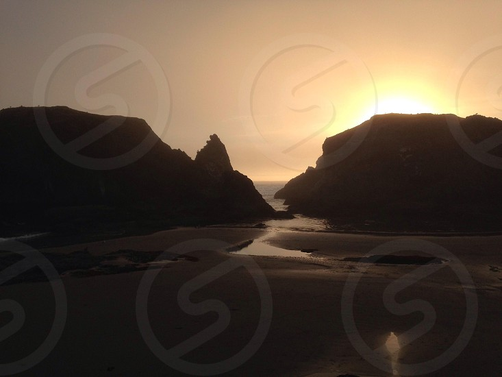 gray sand and rock formation photography photo