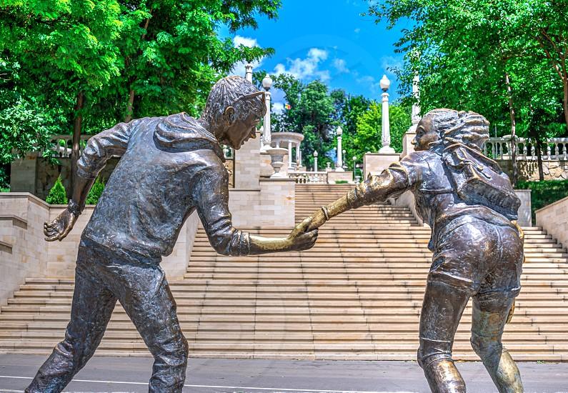 Chisinau Moldova – 06.28.2019. Sculpture by the Valea Morilor Lake in Chisinau Moldova on a sunny summer day photo