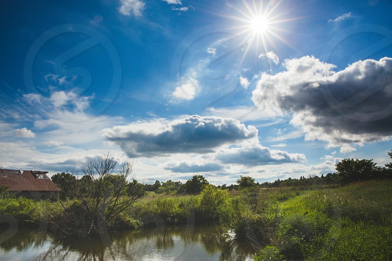 Pond trees reflection summer country farm grass water Missouri rural barn field clouds sun sunburst photo