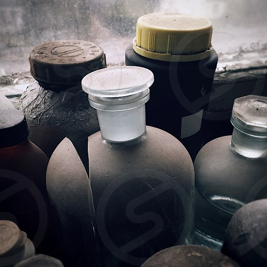 still life flask flasks abandoned chemistry lab laboratory old grunge grungy moody dark contrast black and white window industrial ruins neglected desolate photo