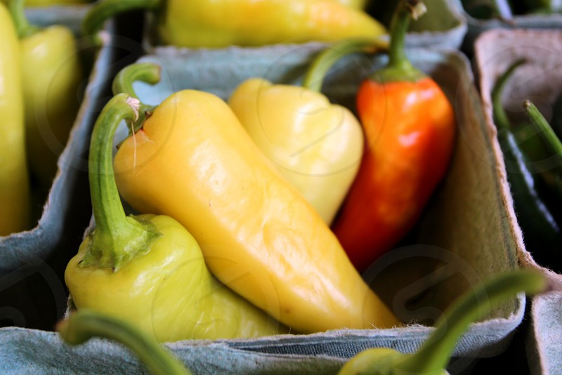 Yellow and red banana peppers photo