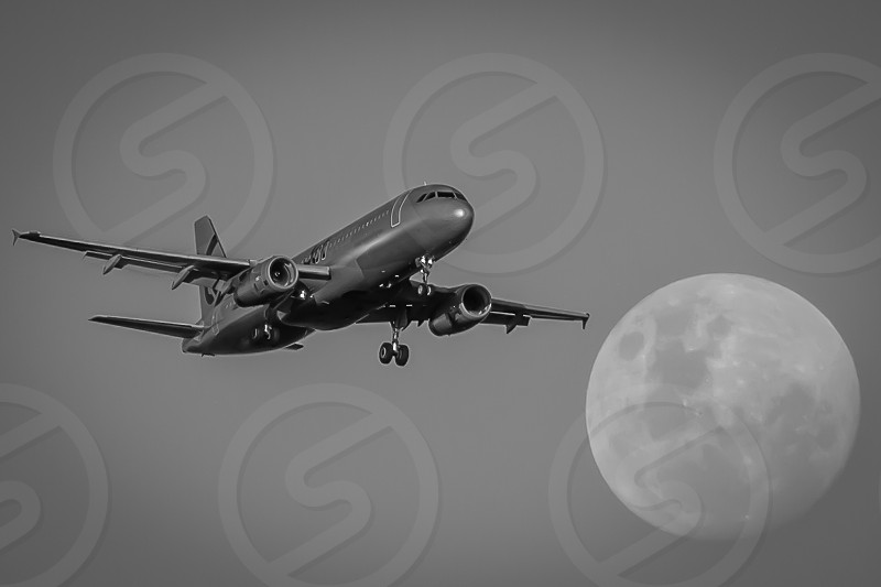 Passing the moon airplanes aeroplane passenger jets landing photo