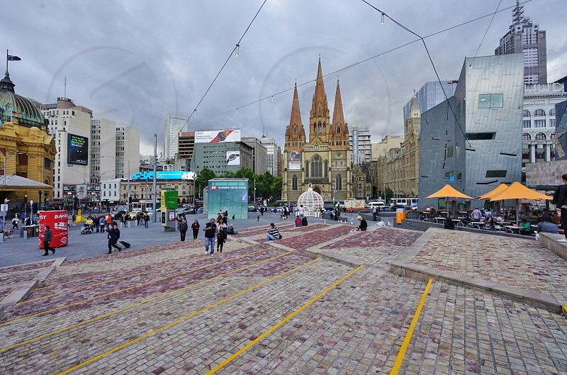 Federation Square Flinders Street Station and St Paul's Cathedral in Melbourne City Center - Melbourne Victoria Australia photo