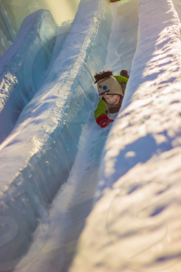 Boy sliding down ice slide in Fairbanks AK photo