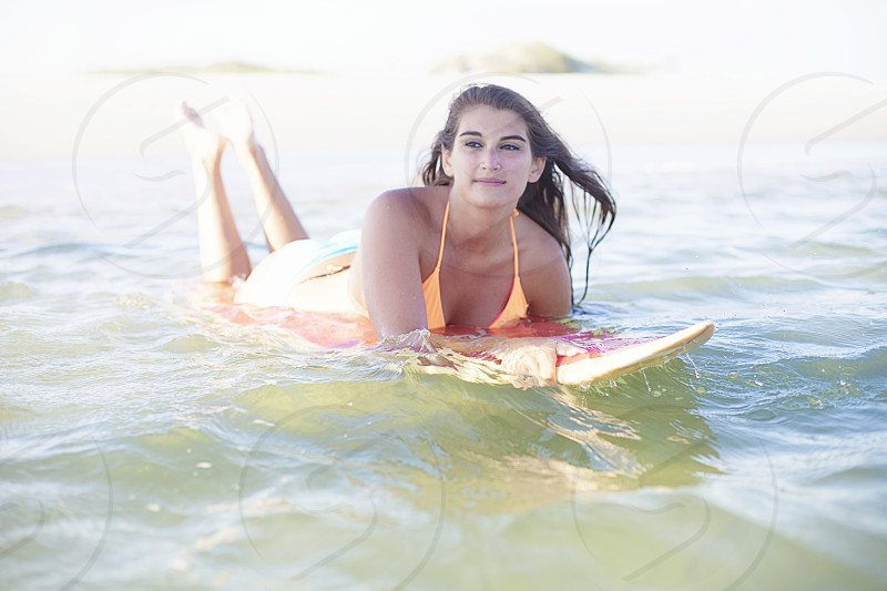 woman on surfing board photo