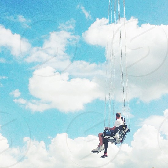 swinging with the clouds photo